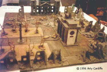 This is an overview of downtown Berlin c.1945 after, Bomber Command and the 8th Air force have done some re-modelling. As modelled by Chris Leach. You are looking at the park to the left and, the Brandenburg Gate at the centre, with the Reichstag in the background. Knocked out German vehicles litter the streets. The Soviet Shock troops are massing in the burnt out buildings in the foreground.